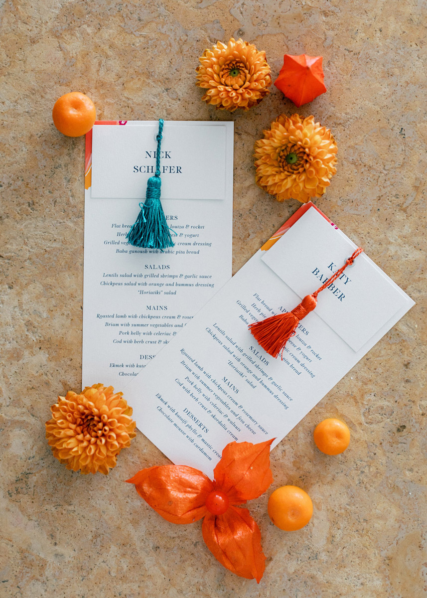 colorful modern art inspired menu card and mane card with colorful tassels